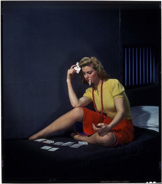 """Nickolas Muray, """"Woman in cell, playing solitaire"""", 1950"""