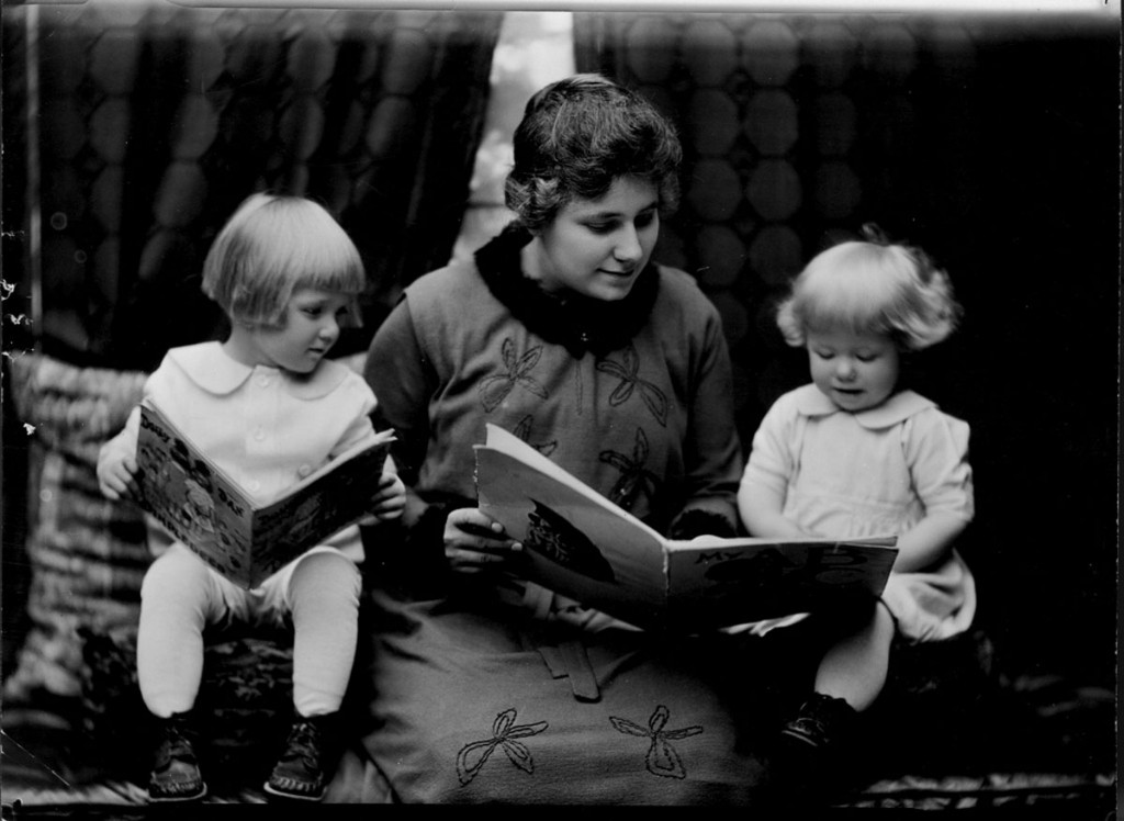 Student reading to two little girls. Photographed for 1920 home economics catalog by Troy, Cornell University Library