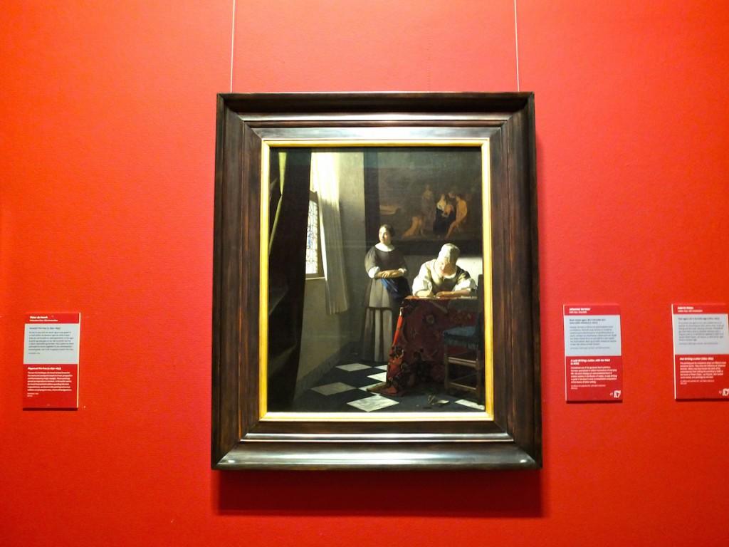 Tableau Une femme écrivant une lettre, avec sa servante (1670) de Johannes Vermeer
